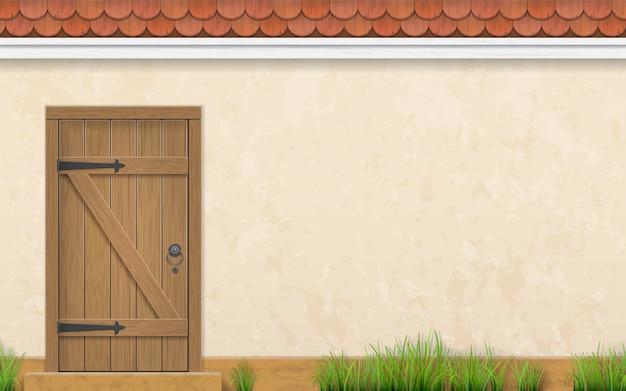 Parete dello stucco di una casa con una vecchia porta di legno Vettore Premium