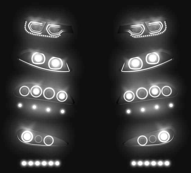 Parte anteriore dell'automobile moderna, insieme realistico di vettore dei fari posteriori. bianco commutato e incandescente nelle tenebre, veicolo led, xenon o luci di corsa laser illustrazione isolato su fondo nero. attrezzature per l'industria automobilistica Vettore gratuito