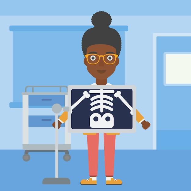 Paziente durante la procedura a raggi x. Vettore Premium