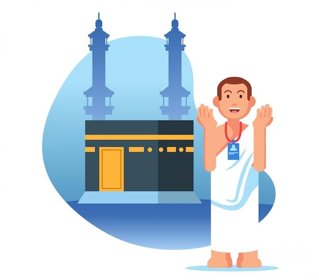 Pellegrinaggio maschile hajj prega vicino a kaaba Vettore Premium