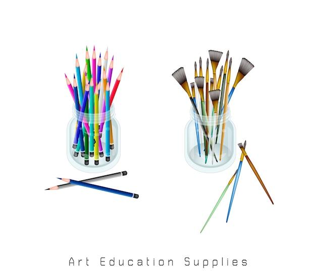 Pennelli dell'artista e matite colorate in un barattolo Vettore Premium
