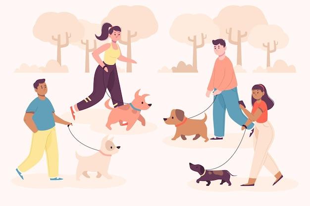 Persone che camminano nel parco con i loro cani Vettore gratuito