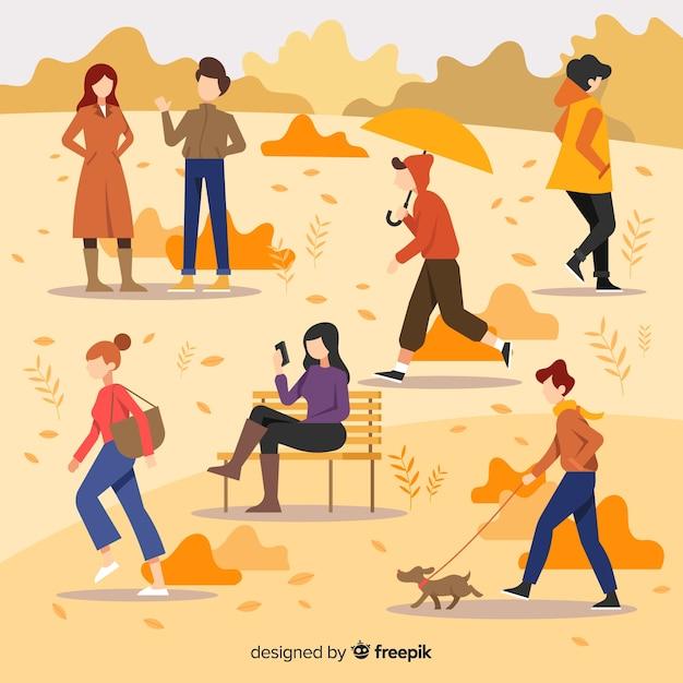 Persone piatte che camminano in autunno Vettore gratuito
