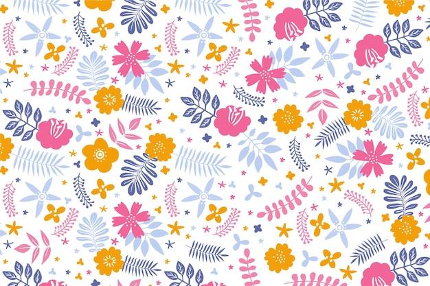 Petali colorati di fiori sfondo Vettore gratuito