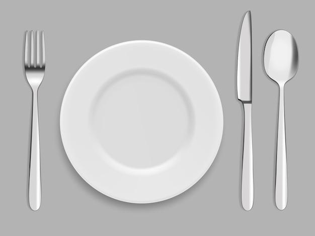 Piatti e posate. forchetta, cucchiaio e coltello Vettore Premium