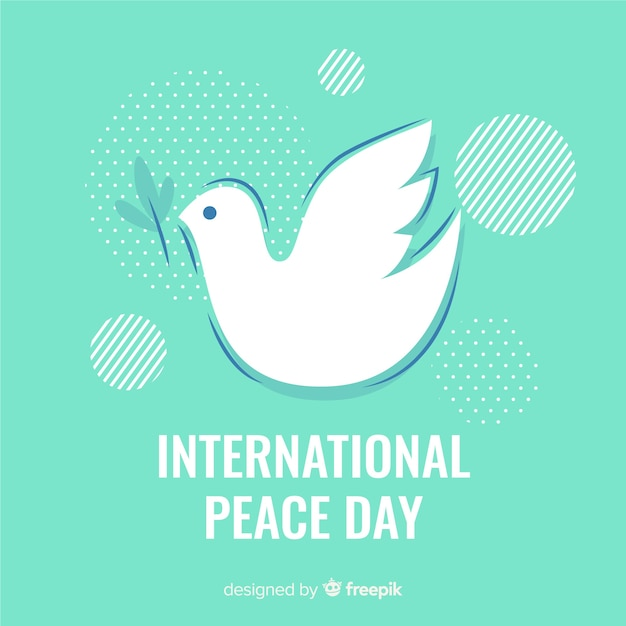Piatto giorno di pace con sfondo colomba Vettore gratuito