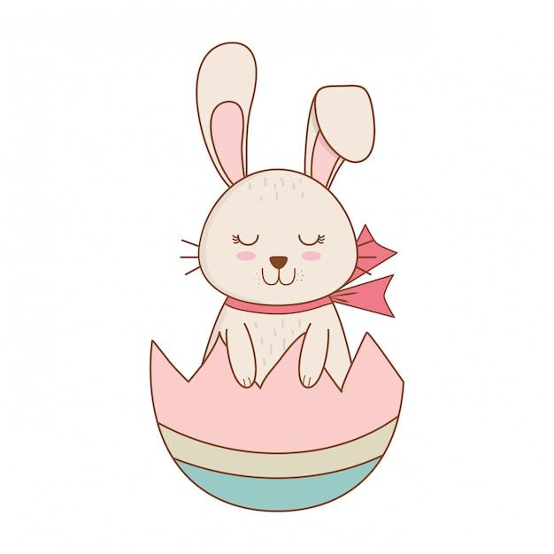 Piccolo coniglio con carattere di pasqua verniciato rotto uovo Vettore Premium