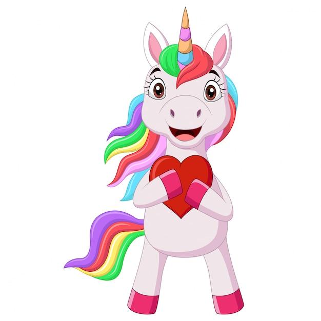 Piccolo unicorno di cavallino sveglio che tiene cuore rosso Vettore Premium