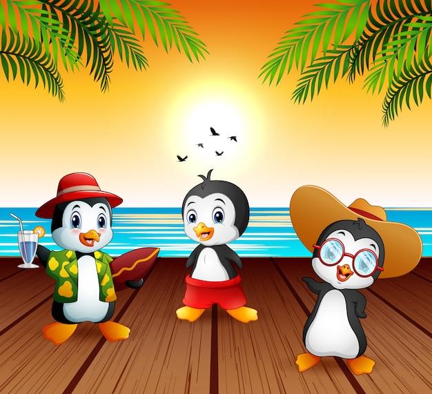 Pinguini simpatico cartone animato in vacanza estiva Vettore Premium