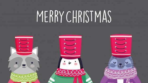 Pinguino di procione celebrazione di buon natale e foca monaca con sciarpa cappello Vettore Premium
