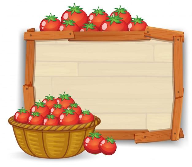 Pomodoro su tavola di legno Vettore Premium