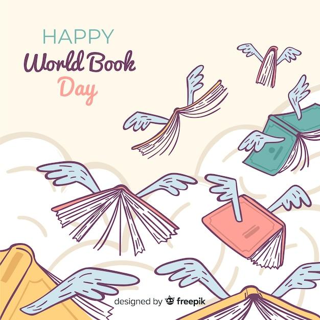 Priorità bassa di giorno del libro di mondo disegnato a mano Vettore gratuito