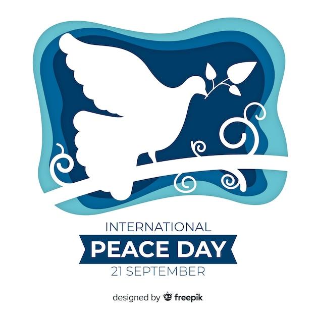 Priorità bassa di giorno di pace di carta con la colomba Vettore gratuito