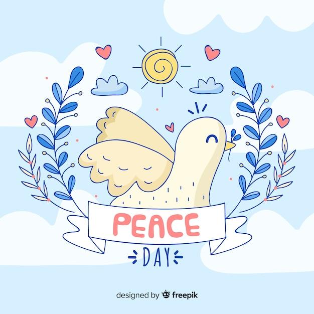 Priorità bassa di giorno di pace disegnata a mano con colomba Vettore gratuito