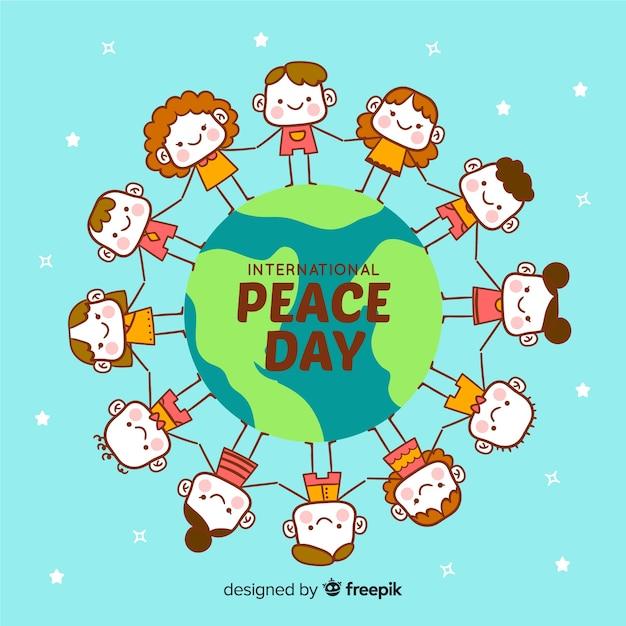 Priorità bassa di giorno di pace disegnata a mano con i bambini Vettore gratuito