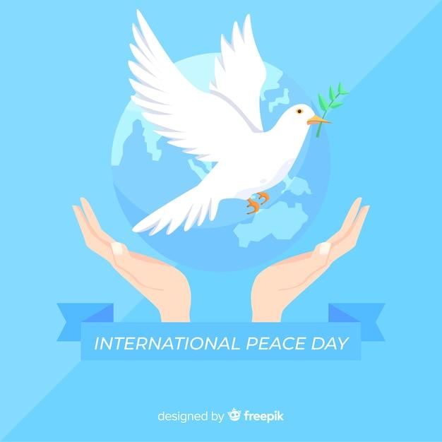 Priorità bassa di giorno di pace piatta con colomba Vettore gratuito