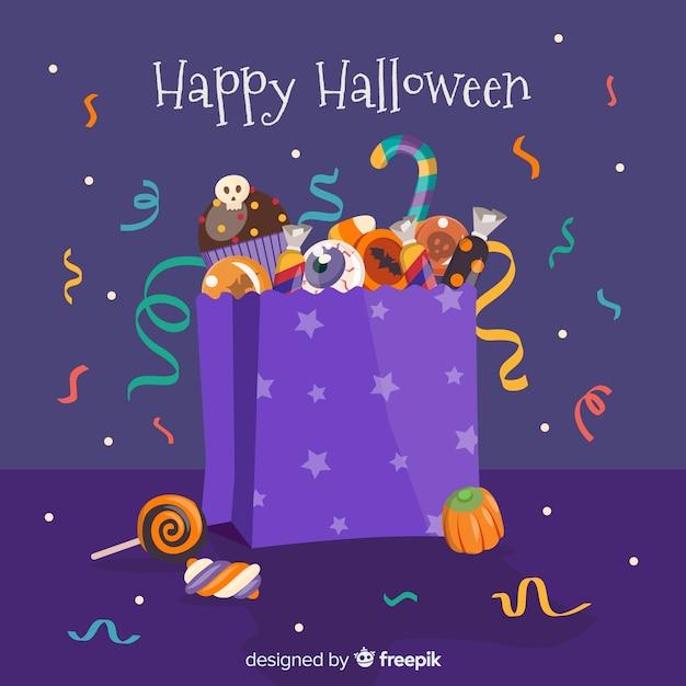 Priorità bassa variopinta della borsa della caramella di halloween nella progettazione piana Vettore gratuito