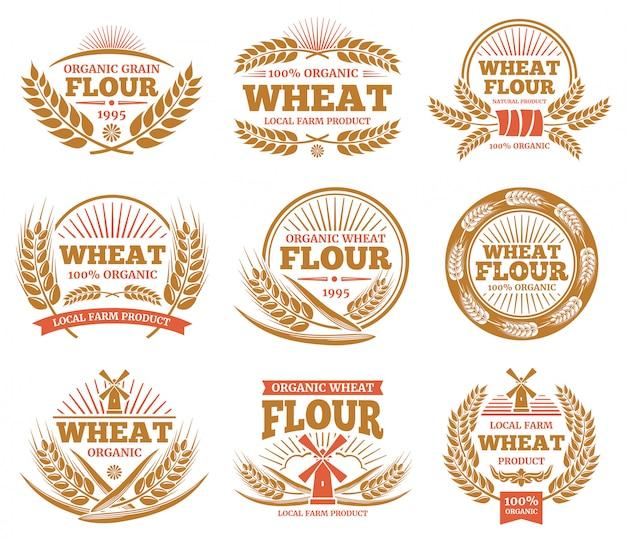 Prodotti di grano e etichette di pane. distintivi di spighe di grano natura. Vettore Premium