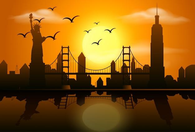 Profili la scena con le costruzioni nella città al tramonto Vettore Premium