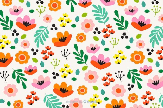 Progettazione piana del fondo variopinto dei fiori Vettore gratuito
