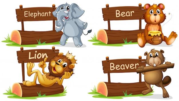 Quattro animali selvatici con cartello in legno Vettore gratuito
