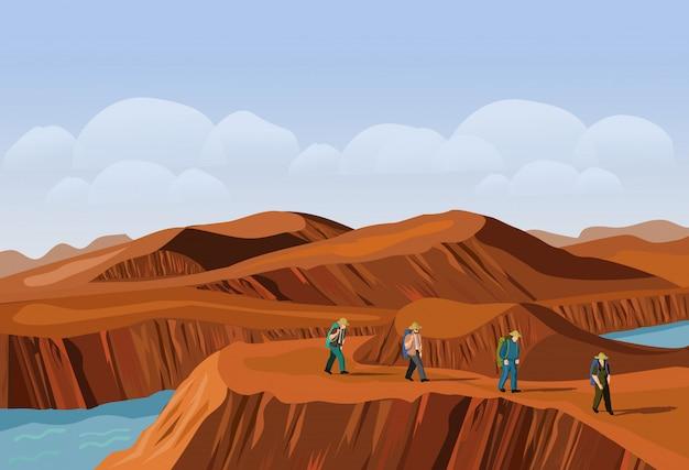 Quattro turisti stanno camminando sulla montagna del deserto Vettore Premium