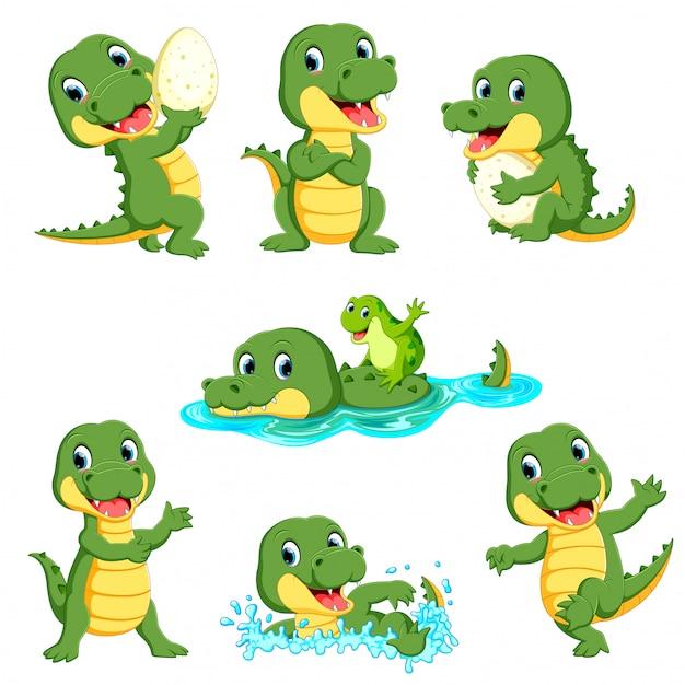Raccolta di simpatici cartoni animati di coccodrillo Vettore Premium