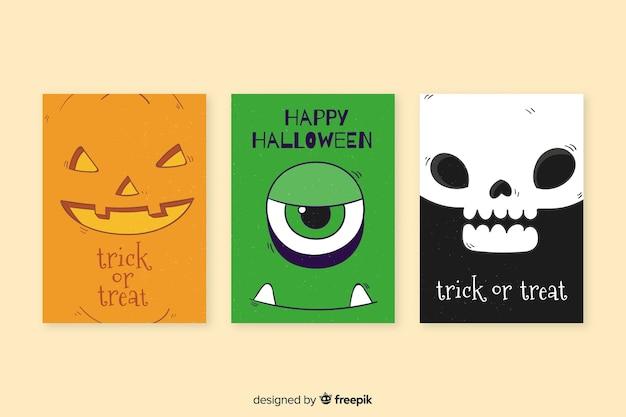 Raccolta disegnata a mano del modello della carta di halloween Vettore gratuito