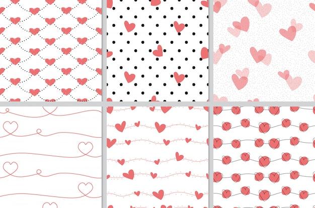 Raccolta senza cuciture del modello del cuore di scarabocchio rosso di san valentino Vettore Premium