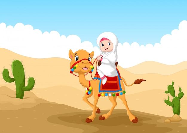 Ragazza araba in sella a un cammello nel deserto Vettore Premium
