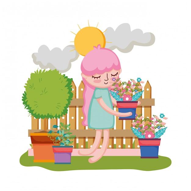 Ragazza che alza la pianta da appartamento con recintare il giardino Vettore Premium