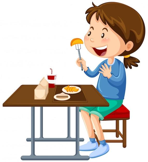 Ragazza che mangia al tavolo da pranzo mensa Vettore gratuito