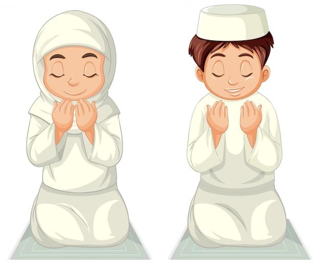 Ragazza e ragazzo musulmani arabi nella posizione seduta pregante dell'abbigliamento tradizionale isolata su fondo bianco Vettore gratuito