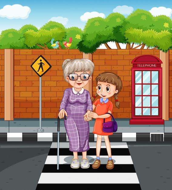 Ragazza e vecchia signora che attraversano la strada Vettore gratuito