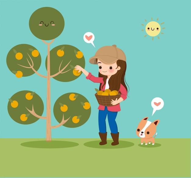 Ragazza sveglia che raccoglie frutta arancio nel giardino con un cane Vettore Premium