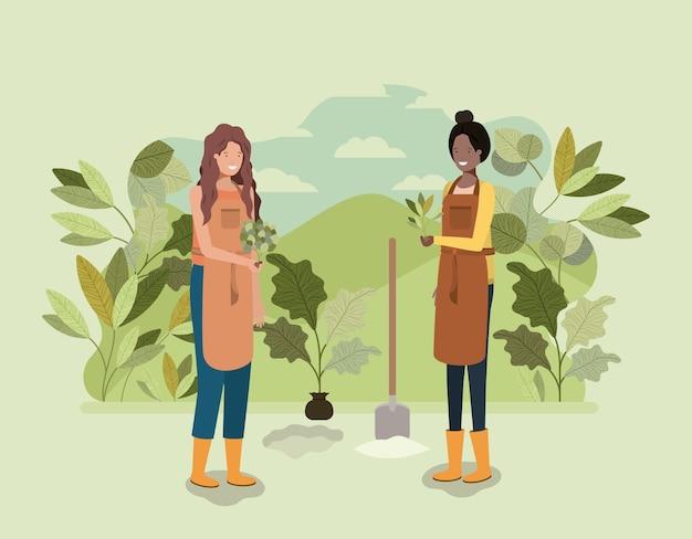 Ragazze che piantano alberi nel parco Vettore Premium