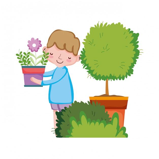 Ragazzo che alza houseplant con albero e cespuglio Vettore Premium