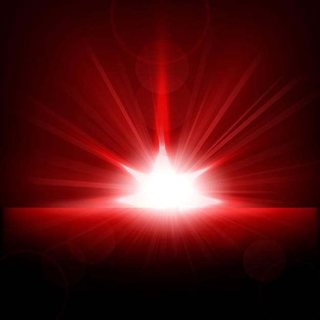 Raggi rossi che sorgono dall'orizzonte Vettore Premium