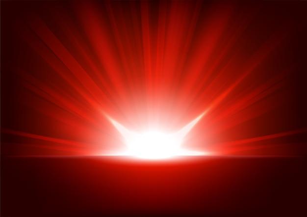 Raggi rossi in aumento su sfondo scuro Vettore Premium
