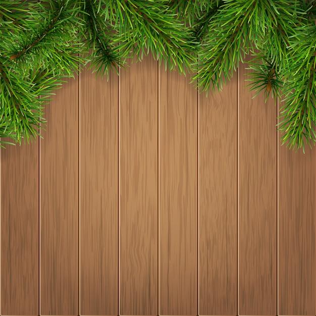 Rami di abete su assi di legno Vettore Premium