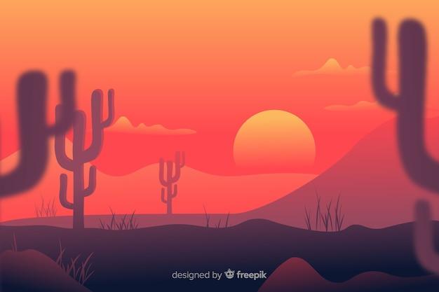 Rami sfocati di cactus e tramonto Vettore gratuito