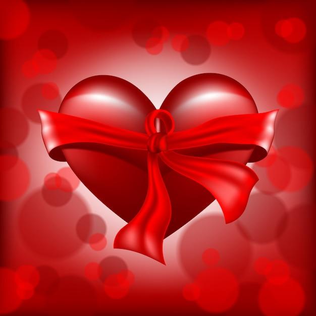 Realistico cuore rosso con nastro Vettore Premium
