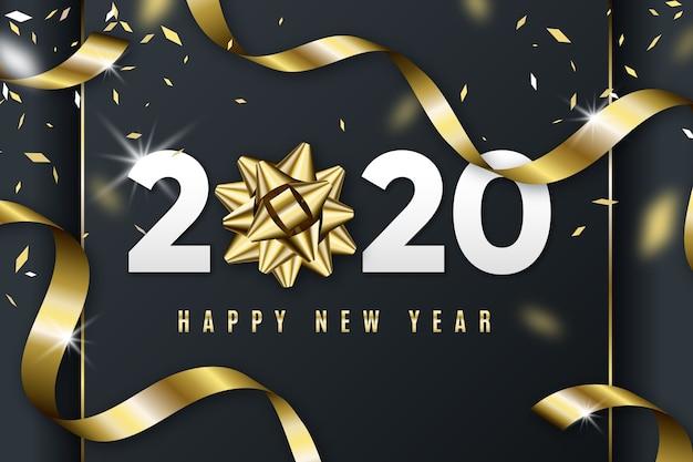 Realistico sfondo del nuovo anno 2020 con fiocco regalo dorato Vettore gratuito
