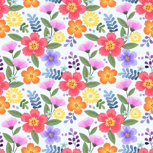 Reticolo senza giunte di fiori disegnati a mano colorati Vettore Premium