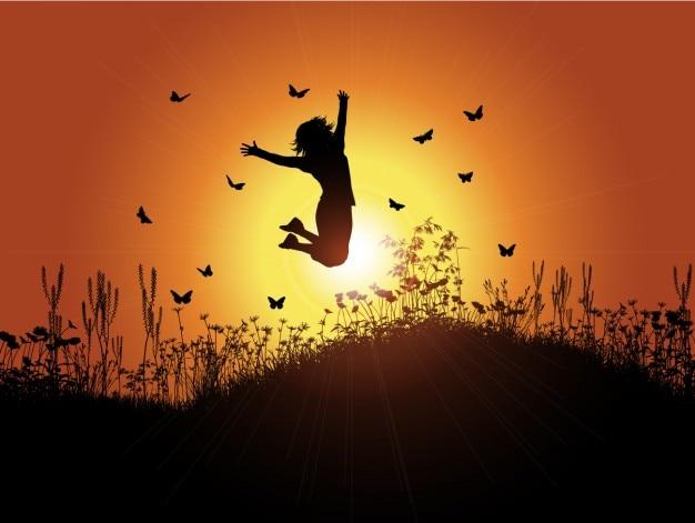 Retroilluminato ragazza con sfondo tramonto Vettore gratuito
