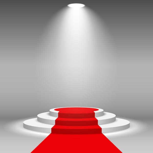 Riflettori scena scena podio illuminato con tappeto rosso Vettore Premium