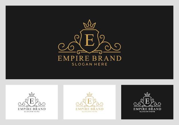 Royal, impero, regno logo design vettoriale Vettore Premium