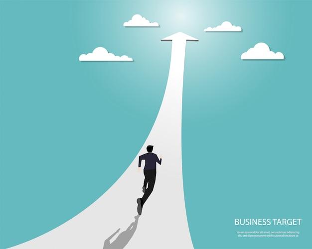 Runnnig dell'uomo d'affari sulla freccia verso l'obiettivo Vettore Premium