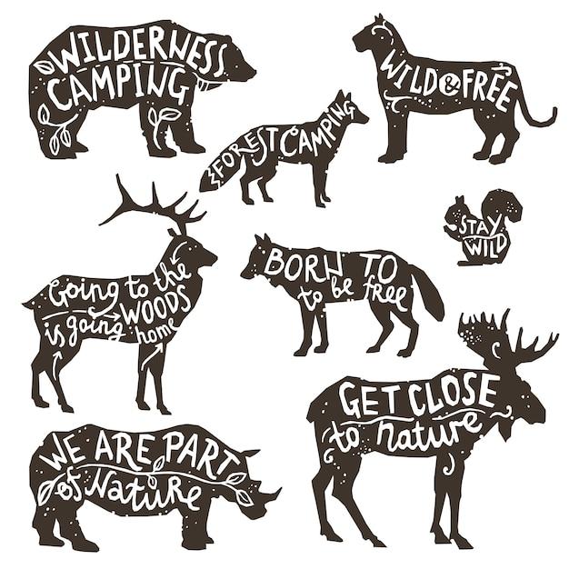 Sagome di animali selvatici con lettering Vettore gratuito
