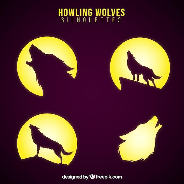 Sagome di lupi con la luna Vettore gratuito